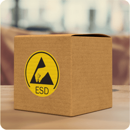 A cardboard box with a yellow ESD sign
