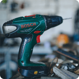 A black and green Power Drill