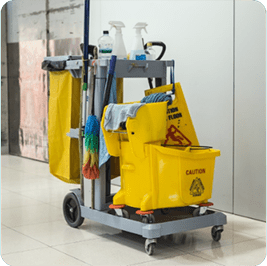 A janitorial cart with a yellow trash bin